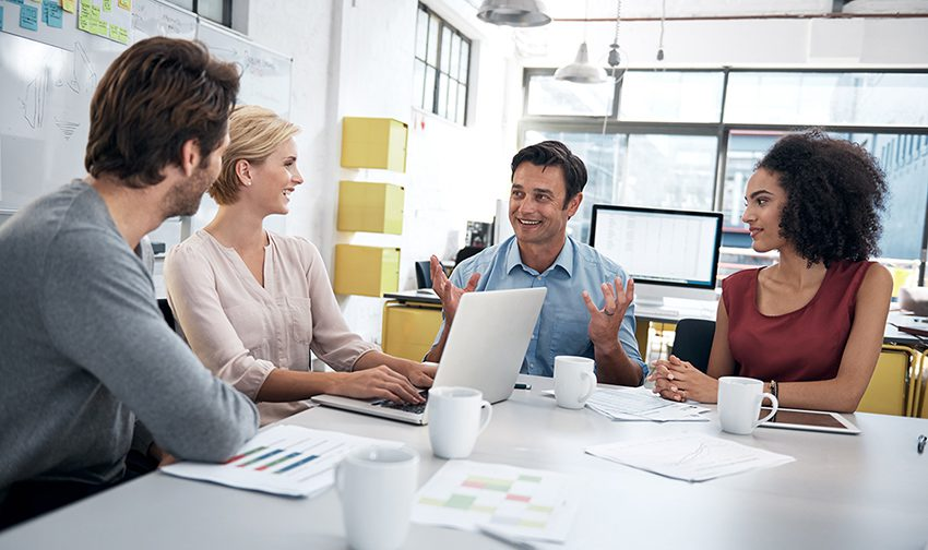 Team of business people having meeting at conference table