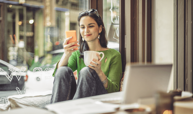 Best BYOD security practices for mobile, Woman looking at mobile device while working in a coffee shop